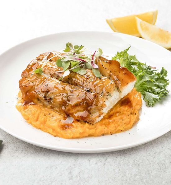 Glazed Atlantic Pollock over a bed of mashed sweet potatoes